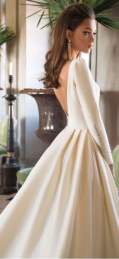 Long Sleeves Simply A Line Wedding Dress: Milla Nova Wedding Dress . Long sleeve simple a line wedding dress: Milla Nova wedding dress . Perfect Wedding Dress, Dream Wedding Dresses, Bridal Dresses, Modest Wedding, Pageant Dresses, Simple Wedding Dress Sleeves, Sleek Wedding Dress, Wedding Dress Buttons, Simple Wedding Gowns