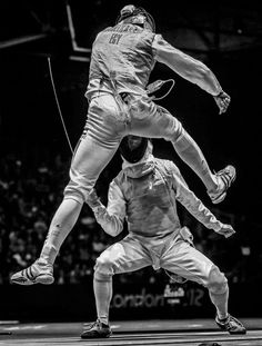 Sergei Ilnitsky of Russia, a photographer working for the European Pressphoto Agency, has won the second prize in the Sports Action Stories category of the World Press Photo Contest 2013 with the series The Golden Touch - Fencing at the Olympics. The picture shows Alaaeldin Abouelkassem of Egypt (top) in action against Peter Joppich of Germany during their Men's Foil Individual Round 16 at the London 2012 Olympic Games in London