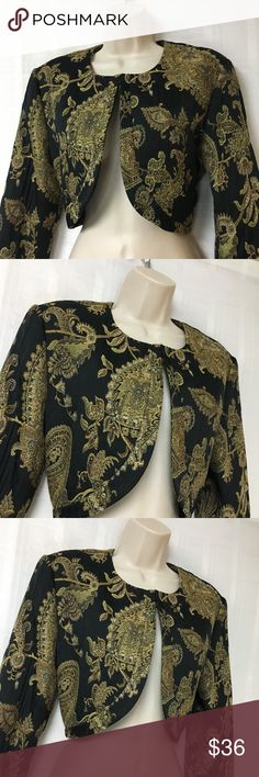 Joseph Ribkoff Black/Gold Pattern Bolero Jacket 10 This jacket is stunning and my pictures do not do it justice! It has a vintage look and the colors are vibrant and stunning. You can wear it over a black dress to give it a dressy and classy look. So many outfit options! Joseph Ribkoff Jackets & Coats