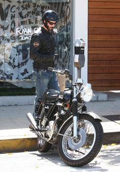 Actor Keanu Reeves sports his Harley Davidson jacket while running errands on his motorcycle in West Hollywood, CA on September 26th, 2012. Keanu's big budget comeback movie 'Ronin 47' has been delayed to due a balloning budget of over $225 million!