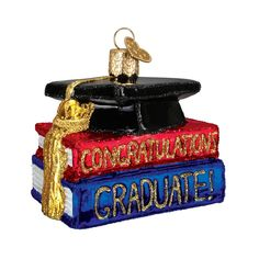 """Successfully completing a course of studies to graduate from high school or college is a significant accomplishment. This beautiful, handcrafted glass """"Congrats Graduate!"""" ornament makes a perfect keepsake to commemorate this important event. Old World Christmas Ornaments, Christmas Gift Box, Family Christmas, Ornament Hooks, Glass Ornaments, Graduation Ornament, College Graduation Gifts, Graduation Caps, Personalized Christmas Ornaments"""