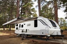 Lance Camper builds America's favorite truck camper and ultra light weight travel trailers all DSI award winning and eco green friendly. Truck Bed Camper, Popup Camper, Lance Campers, Rv Show, Fifth Wheel Campers, Electric Awning, Rv Accessories, Construction Design, Old Models