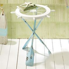 A wonderful and functional accent piece for your beach house or coastal decor Ships Ahoy Accent Table has three distressed blue oars for legs Table top is a whi