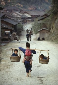 Two in the side cars and one on the back at Guizhou, China
