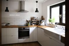 a few ideas that I like - wooden bench top, black windows, no open shelves *insert fridge to the left and an island for more space*