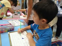 My older son coloring at #TGS2015