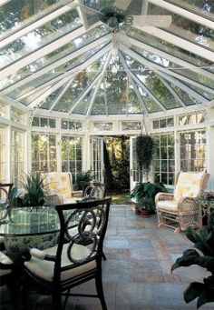 This #conservatory creates a warm, welcoming atmosphere by using potted and hanging plants that seamlessly blends the inside ambiance with the outside. Tanglewood Conservatories, Ltd. http://www.luxurypools.com/blog/entryid/113/6-beautiful-backyard-conservatories.aspx#