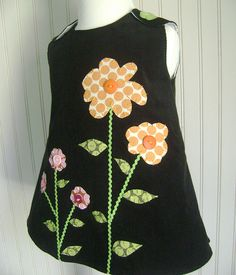 Cute idea for applique dress - would make it in a different silhouette, though.
