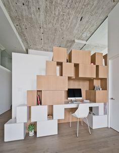 Doehler loft renovation by SABO Project features an irregular clustered storage unit