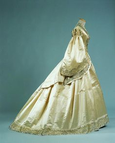 Wedding dress, 1862 From the Palazzo Pitti. worn by Mrs. Emilia Tedeschi on her wedding day to English painter Sir John Henry Bradley, ivory silk satin