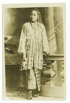 malay girl in veil and tunic