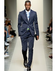 The Cotton Suit -   We used to talk about cotton being an addition to your wardrobe; now, it almost feel like every summer suit should be cotton. If you already have a basic khaki and navy, it's time to spring for a gray, a seersucker, or even a two-tone suit. And embrace the wrinkles. They add a little attitude to your look.    By Bottega Veneta