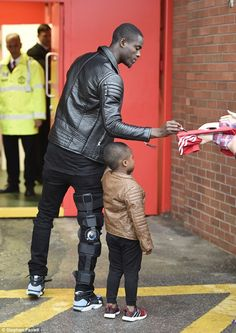 Eric Bailly arrives at Old Trafford in knee brace as Manchester United defender begins road to recovery