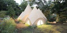 """Renowned Japanese architect Issei Suma designed a serene """"tent"""" home in the forest for two retired ladies and their caretaker and chef. The beautiful design and magical setting has us thinking: it might be time for retirement. Shizuoka, Japan Design, Stone Age Houses, Tenda Camping, Tiny House France, Mont Fuji, Forest House, Japanese House, Elle Decor"""