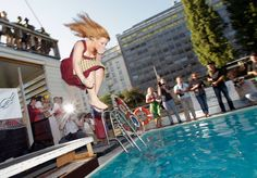 "A participant of the the ""Dirndlspringen"" contest jumps into a swimming pool in Vienna, on June 16, 2012."