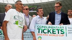 Jose Maria Marin , Brazilian Football Confederation President and Jerome Valcke, FIFA Secretary General give a commemorative World Cup Free Entrance to a construction worker at Castelao Stadium, Fortaleza, one of the hosts cities...