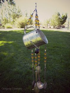 Wind chime with re purposed vintage silver plated flatware - mini flour sifter with amber glass and hematitie beads - Whispering Metalworks
