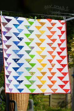 """Rainbow Migrating Geese –Tutorial The formula is: Two squares at a measurement for the background and one square 3/8"""" bigger for the geese (This will yield four migrating/staggered geese)  For the border, I needed a finished six inch border, which dictated that my background squares would be five inches, and my goose fabric would be a 5 and 3/8"""""""
