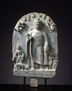 Relief with the Dipankara Jatak Provenance	Gandhara Period	3rd to 5th centuries Century	3-5c Materials	Schist Dimensions	H-69.3