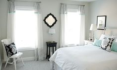 Moonshine by Benjamin Moore.  Love the soft wall color, touches of black and white and the drapes are great.  All = great color combo.  Drapes are