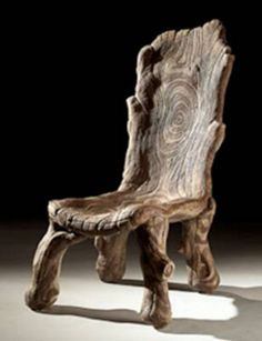 Concrete faux bois chair. It looks like it grew from the earth, but it isn't even wood! #chairjunky http://attheoffice.com