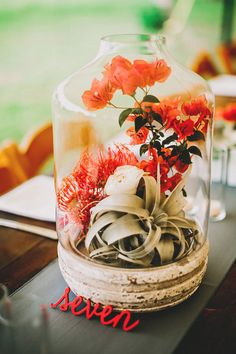 bell jar centerpiece, photo by Two Pair Photography http://ruffledblog.com/the-plant-at-kyle-wedding #centerpieces #flowers #tablenumbers