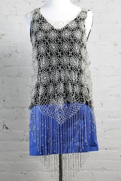 Pair this #elietahari black ruched tank top with a #theory neon blue mini skirt and top it with our #calypso crystal tank top for a cute look on a first date. You'll be sure to land a second date with this outfit!  All items are on sale in our Ebay store: http://stores.ebay.com/1roboshipping #womensfashion #crystal #blackandblue #firstdate #springfashion #summerfashion #forsale #ebay
