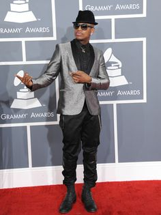 Ne-Yo arrives at the 55th annual Grammy Awards on Sunday, Feb. 10, 2013, in Los Angeles.