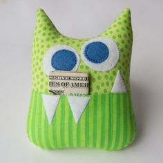 "I added a new tooth fairy pillow design to my Etsy shop today.  It is a ""little monster"" in green dots and stripes with an initial ..."