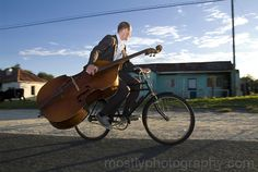 My friend Paul Gibbings, contra bass player on vintage bicycle.