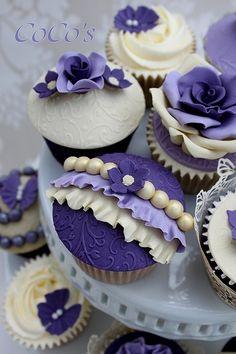 Vintage-inspired purple wedding cupcakes in a tower - so lovely #wedding #weddingcupcake #cupcakes #cupcaketower #vintage