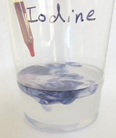 Iodine reacting with starch to make a blue-purple-color.