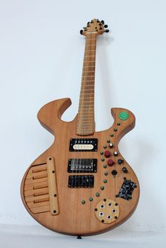 Made this for Joe Pepe of the band Illimanjaro.  I met Joe at the lumber yard where he works - Joe sells primarily Antique Heat Pine, and that's what this guitar is made from.  It has a Casio keyboard circuit, 6 sound Mr. T novelty keychain with pitch knob, and a Loop / Sampler pedal made by Boss.  http://bensimonmusic.com/bensimonmusic.com/Instruments.html