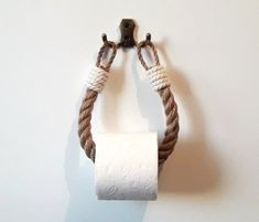 Simple but effective toilet paper holder, perfect for a wide variety of bathroom styles. Handwork and eco-friendly materials. The holder is made of natural jute and cotton rope. Easy mounting of the holder to the wall with two screws. The holder is suitable for rolls of paper with a hole - from 3 cm #ropes #ropeideas Jute, Nautical Bathroom Decor, Nautical Interior, Rope Crafts, Yarn Crafts, Eco Friendly Fashion, Paper Storage, Toilet Paper Roll, Diy Toilet Paper Holder