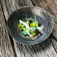Tri-color quinoa, royal blue potato cooked in butterfly pea broth, fennel, morel, asian radish, local flowers, white tea broth, and coriander oil.