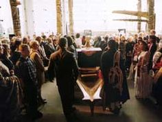 Photo: Bill Reid's ashes being carried in a canoe at his funeral UBC MOA 1998