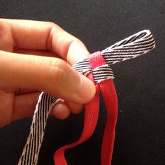 Here's a bit of a throwback — weaving ribbons, but in this case, shoelaces.   Step 1: Fold the shoelaces together 3 to 5 inches from the aglet (the end of a shoelace). That …