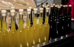 The olive oil bottles are filled and ready to be sealed!