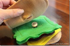 button sandwich works on fine motor, bimanual and visual perceptual skills as well as ADL's for buttoning
