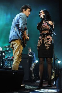 Katy performs in a black Temperley London floral dress with John Mayer in Brooklyn.