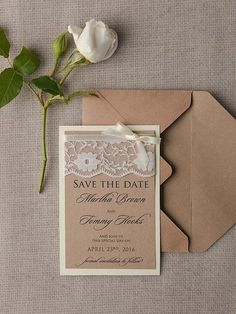 The dainty lace on this save the date gives a rustic touch to an otherwise formal looking stationary piece. The perfect balance between country and city, we can already picture toasting the health of the bride and groom at an elegant wedding with some vintage accents.