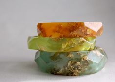 lime green wavy eco resin bangle with gold flakes. $150.00, via Etsy.