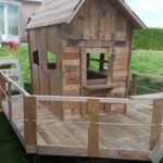 We built this Round-Window Kid's Pallet Playhouse to be sturdy and fun. We included a kid-sized deck/porch area and railings to keep the little ones safe.