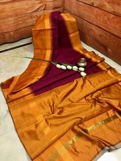 This authentic, Silk Mark Certified pure Raw Silk Saree is simply stunning. Unique color combination of Wine color body with Metalic Deep Orange temple border and pallu, this saree is a complete stunner. Raw Silk Saree, Chanderi Silk Saree, Silk Sarees, Indian Sarees, Saree Blouse Neck Designs, Saree Blouse Patterns, Simple Frocks, Orange Color Combinations, Wedding Silk Saree