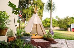Teepee Covered Sandbox.  Beach Away From Home: 8 Cool Sandboxes That InspirePlay
