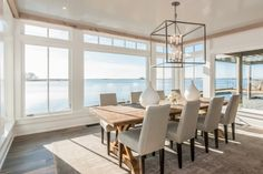 Dinner on the water, every night at Shorehaven. Beach House Kitchens, Home Kitchens, Interior Design Guide, Highland Homes, Transom Windows, Dining Room Lighting, Interior Lighting, Home And Family, New Homes