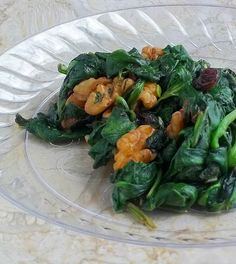 Sauteed Spinach with Raisins and Walnuts. I used kale instead of spinach and did not add salt. I also tried subbing out the garlic for the juice of half a lemon, and that was nice. Super quick, easy, and flexible, but doesn't store super well. Make as much as you need for 1 meal.