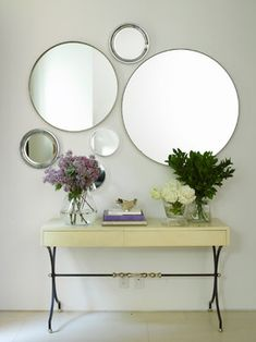 Fresh cut flowers and various sized mirrors // entryway styling