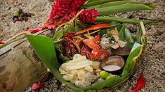 Coconut crab and seafood platter | For the best results, use the freshest seafood you can afford for this recipe. It is served with two sauces - both have lime juice and chilli, but one is made with rich, sweet coconut cream, and the other with seawater (though at home, you can used salted water).