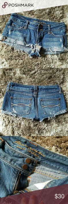 Abercrombie and Fitch Cutoff Denim Shorts These cutoff denim shorts by Abercrombie and Fitch make an effortless summer outfit. Perfectly distressed, featuring a two-button closure. Size 0. Abercrombie & Fitch Shorts Jean Shorts